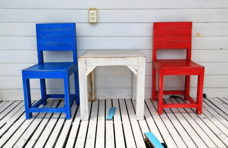 Red and blue chair on the wooden floor photo