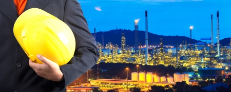 construction engineer with oil plant Stockfoto