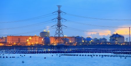 liquefied: Chemical danger industrial storage sphere tanks with high voltage poles  Stock Photo