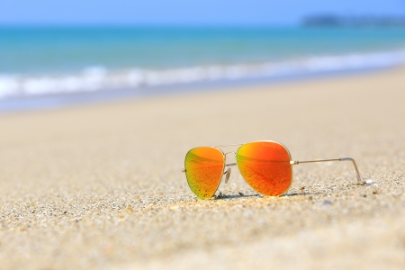 phangnga: Sunglasses color orange on a sandy beach
