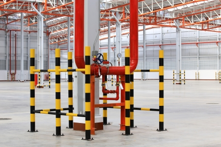 Industrial zone, Steel pipelines and valves against in warehouse area