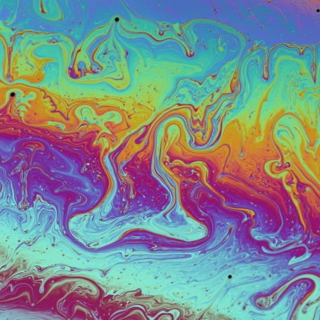 Rainbow colors created by soap, bubble, or oil makes can use background  photo