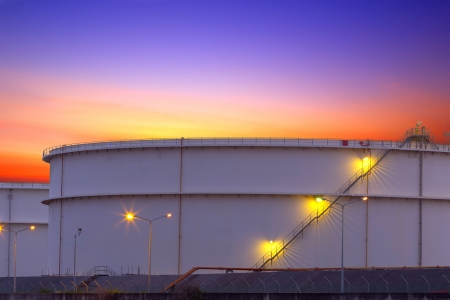 big Industrial chemical tanks in a refinery at twilight photo