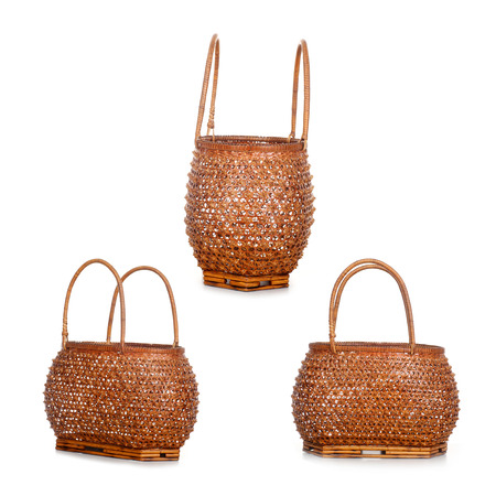 vintage Thai style weave wicker basket isolated on white  photo