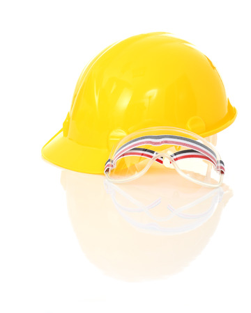 class maintenance: Yellow safety helmet and goggles with reflect on white background