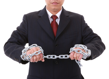 exert: A businessman to make a pull  chain links Stock Photo