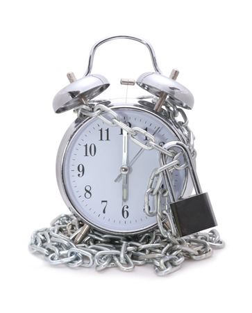 time bound: Clock bound with chain and padlock concept stop time