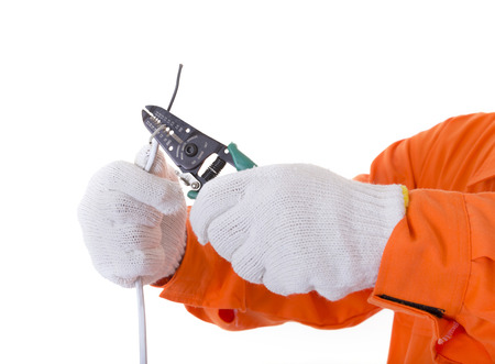 cable cutter: Man hand hold cutter ready to cut electrical wire or cable. Isolated white background Stock Photo
