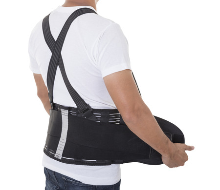 in the back: Worker wear back support belts for support and improve back posture. Stock Photo