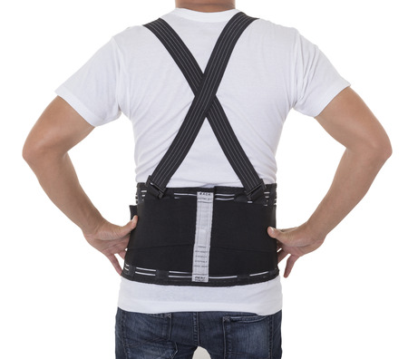 Worker wear back support belts for support and improve back posture. Archivio Fotografico