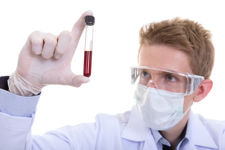 protective goggles: Investigator checking test blood in tubes. Man wears protective goggles
