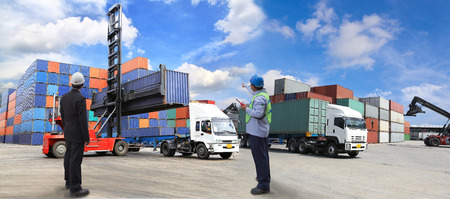 trade: forklift handling the container box at dockyard