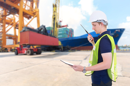 foreman: foreman control loading Containers box from Cargo freight ship at harbor Stock Photo