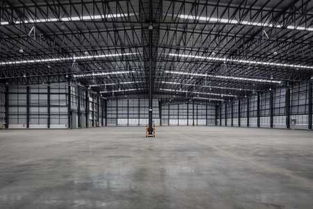 empty modern warehouse for distribution goods. Stock Photo