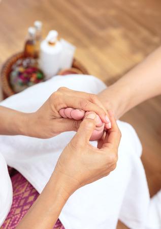Foot massage in spa salon,Thai massage.