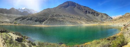 Borith lake is located near Passu Glacier and Ghulkin glacier at spring season in the northern Pakistan. Stock Photo