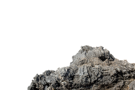 Cliff stone acrimonious located part of the mountain rock put on the top of hill isolated on white background. Imagens