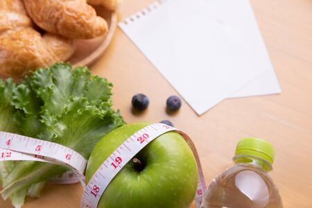 Diet plan, menu or program, tape measure, water and diet food, weight loss and detox concept. 스톡 콘텐츠