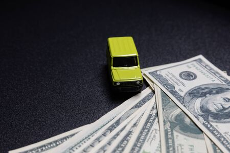 toy car model with money banknotes 스톡 콘텐츠