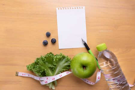 Diet plan, menu or program, tape measure, water and diet food, weight loss and detox concept. Stock Photo