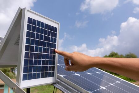 Engineer solar photovoltaic panels station checks