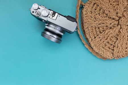 Camera with bag on blue background. 스톡 콘텐츠