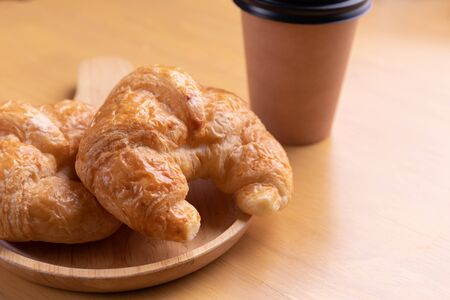 freshly baked croissants and coffee cup on table. 스톡 콘텐츠