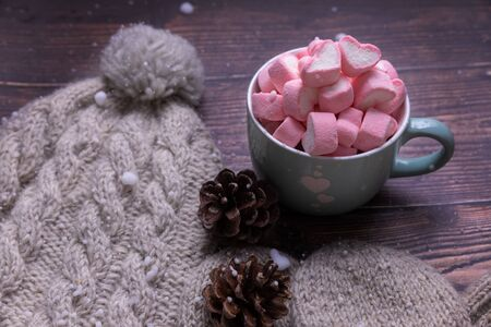 candy marshmallows on table with snow, top view