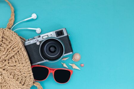 Traveler accessories on blue background with retro camera