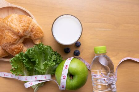 tape measure and water and diet food, weight loss and detox concept.