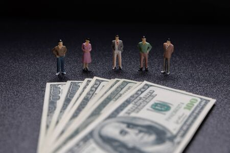 Miniature people: Group of small businessmen standing on coin with  Business Growth concept.