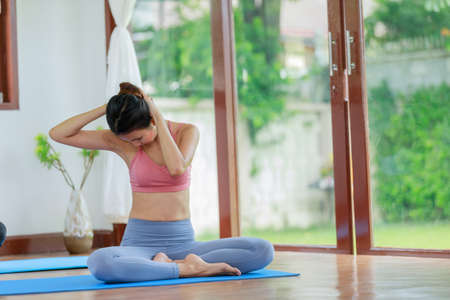Young woman relaxation yoga alone in the room at home.