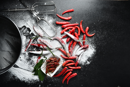 red chilli pepper plant: Red Hot Chili Peppers on dark background with flour, Copy-space background.