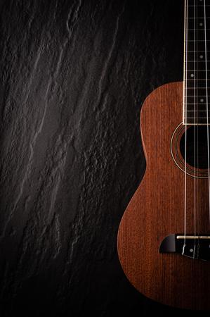 bluegrass: a ukulele on black