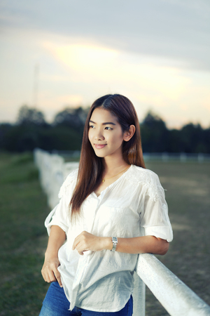 unusually: woman in a farm at sunset stroll and relax , breathe fresh air outdoors.Concept Refresh and beauty