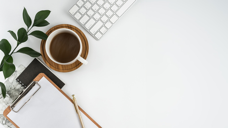 Styled stock photography white office desk table with blank notebook, computer, supplies and coffee cup. Top view with copy space. Flat lay. Standard-Bild