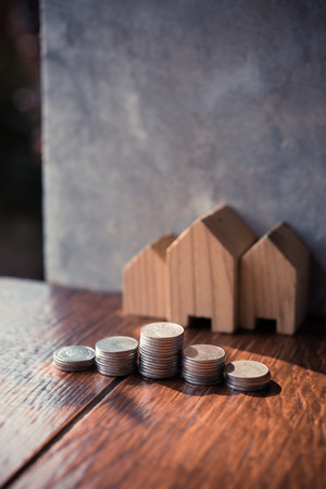 Saving to buy a house or home savings concept with money coin stack growing.Saving money concept. Foto de archivo