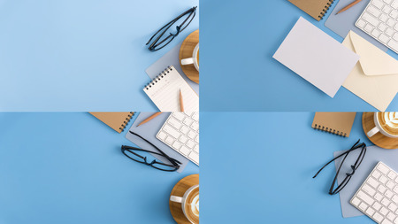 Flat lay, top view office table desk. Workspace with blank note book, keyboard, office supplies and coffee cup on light blue background.