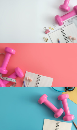 Set of fitness equipment dumbbells notepad pencil and earphone on color background. Top view with copy space. Flat lay
