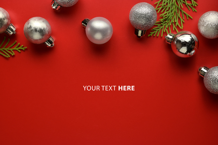 Flat lay, Top view minimal composition background of red decorative Christmas ornaments. New Year and Christmas concept with copyspace.