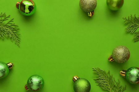 Flat lay, Top view minimal composition background of green decorative Christmas ornaments. New Year and Christmas concept with copyspace.