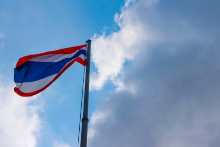 ethnical: Image of waving Thai flag of Thailand with blue sky background  Stock Photo