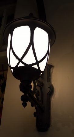 Lighting the way with lamp photo