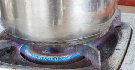 old gas stove: Fire under the cooking pot on the Old gas stove