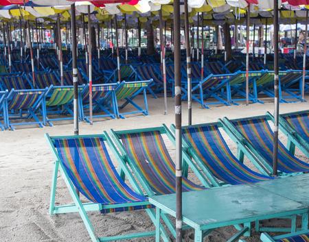 Beach  chairs so much on the beach in sunny day, at BangSan Beach Thailand photo