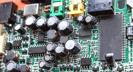 Old Circuit Board with many electrical components  photo