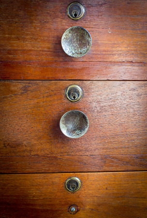 tallboy: Keyhole drawers of a Wooden Dresser Stock Photo