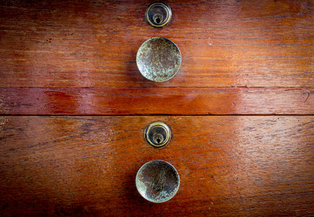 Keyhole drawers of a Wooden vintage Dresser photo