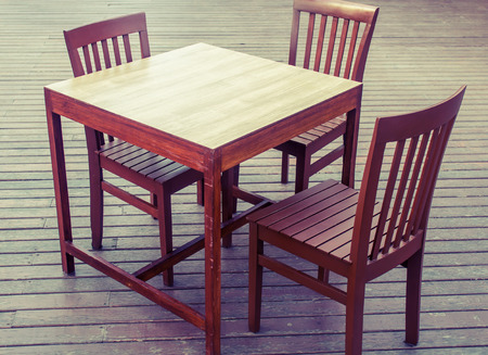 wooden table chairs on flooring wood photo