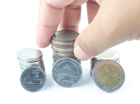 Silver coins of Thailand and white background photo